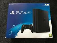 PS4 Pro 1TB boxed and in excellent condition