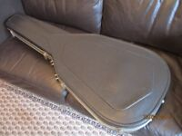 Black light weight but robust vacuum formed carbon fibre look guitar case.