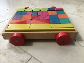 A Toddlers Pull Along Wooden Toys with building blocks