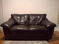 Brown leather 2 seater sofa in excellent condition.