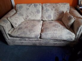 SOFA BED . Small double size with a sprung mattress.