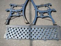 A OLD WROUGHT IRON GARDEN BENCH