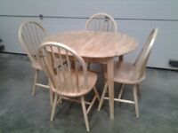 Ex display wooden extendable table and 4 chairs. Bargain Very good. Can deliver.