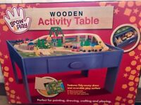 Brand new in. Box- children's wooden activity table with storage drawer