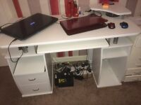 computer desk with 2 drawers, printer shelf and keyboard pull out shelf. Good condition. White.