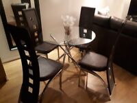 Excellent dining room table and chairs set