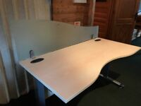 4 office desks in good condition. 2 with removable frosted back boards
