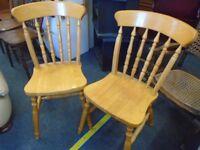 2 modern pine farmhouse chairs.