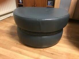 Blue puffy foot stool opens up for storage.