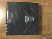 Karomed Transflo foam wheelchair / chair cushion for sale (unused and packaged)