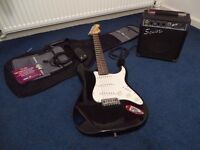 Practically new Fender Squire Strat electric guitar & amp. Location flexible for delivery/pickup.