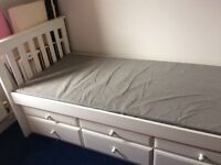 Single bed with pull out drawers and trundle underbed