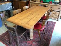 Vintage pine top/beech frame demountable table on casters and 6 various chairs for sale