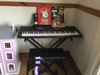 Yamaha keyboard complete with stool and music books