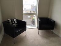 2 x Ikea black leather Klappsta armchairs