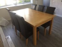 Solid wood dining table with 6 brown leather chairs