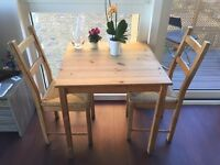 Rustic wooden table and two chairs