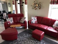 Red Leather Suite (Stressless). 3+2 Sofa with matching footstool and ottoman / coffee table