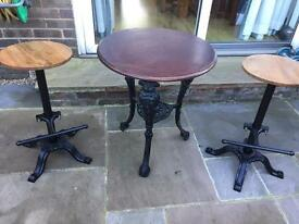 Cast iron pub table and 2 bar stools