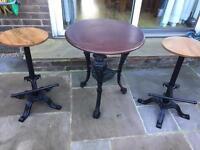 Cast iron pub table and 2 bar stools