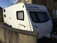 Caravan touring 6 berth great condition. Fixed bunks with additional seating.