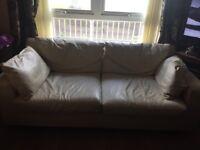 Pair of cream sofas
