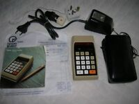 Vintage Texas Instruments TL-2500 calculator + accessories. Offers invited