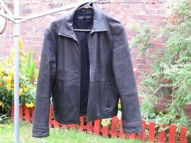 Men's soft black leather zip front jacket. Size medium.