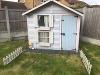 Wooden playhouse slide and swings