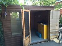 Garden shed/summer house, approximately 3.5m x 3m ply lined and insulated.