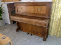 An upright piano A.S.White & Co