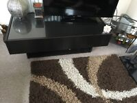 Brown living room table with hidden extendable pull out drawers.