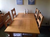 Solid Oak dining table - seats 4 - 8 with extension. Comes with 4 Solid Oak ladder back chairs.