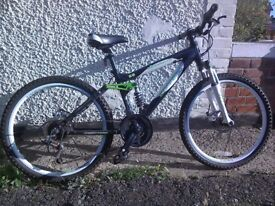 Kids bicycle 23 inch wheels boy/girl suit from 9 years (approx). Light use, stored in shed.