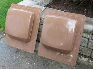 Two brown plastic Roofing vents.