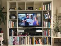 White Ikea TV unit with shelves