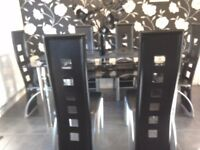 Black glass dining room table and chairs