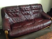 Two red leather, three-seater sofas for sale. Will sell together or separate. Collection only.