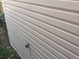 White up and over Electric garage door with metal frame