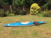 Kayak with splash deck and paddle