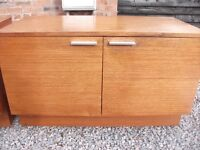 "A PAIR OF MATCHING SOLID TEAK SIDEBOARD CUPBOARDS BY ""LIVING MEMORY"""