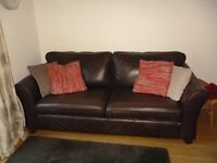 Marks and Spencer leather sofa.