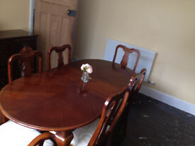extendable dining table and six chairs and cabinet
