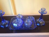 Pretty glass set,one candle stick has a repair.