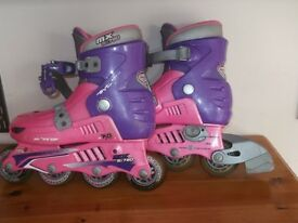 PINK AND PURPLE IN LINE SKATES