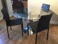 Glass table with chrome pedestal and 4 leather chairs