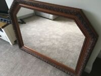 Beautiful mahogany framed mirror with carved detail