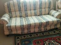 Three piece lounge suite in cream with blue and white stripe detail