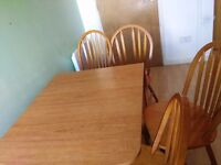Wooden dining table and 4 chairs