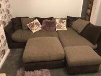 Large L shaped sofa with two footstools